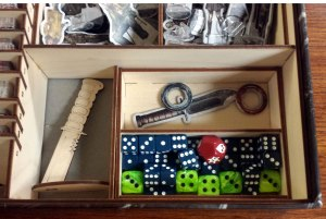 Nothing to see here but a couple knives and some cool looking dice, fit all nice and snug in the box.